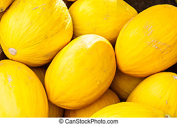 Box of yellow casaba melons for sale at local farmers market