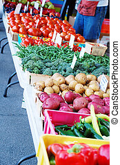 Various vegetable stands at the Farmers Market