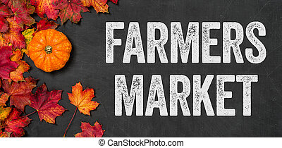 Farmers market written on a blackboard