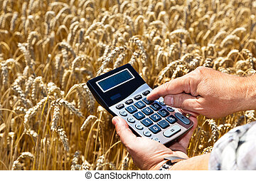 A farmer with a calculator on cereal box. Subsidies in agriculture