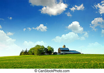 Farmhouse and barn among green fields