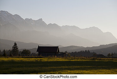 farmhouse in Alps before sunset