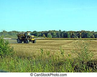 Farming Chore - Spraying liquid fertilizer on a field in a...