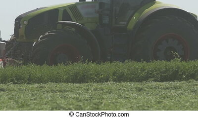 Farming combaine harvester moving on agricultural field for...