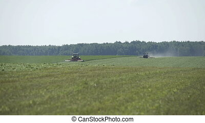 Farming combaine harvesters moving on agricultural field for...