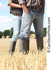 Farming couple in field