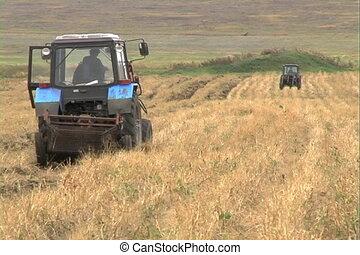 Farming. - Two tractors on field.