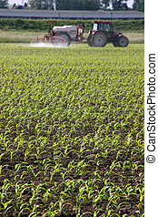 farming - there is a field in the foreground which is ...