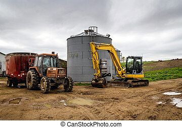 farming tractor and excavator