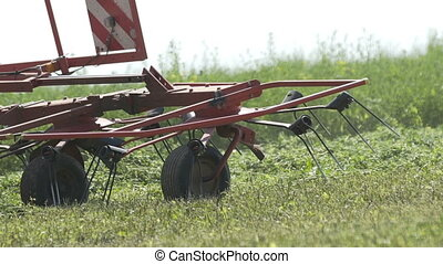 Farming tractor moving on agricultural field for harvesting...