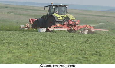 Farming tractor on agricultural field for harvesting land....