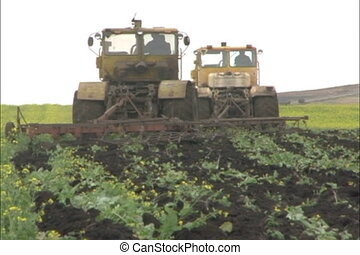 Farming. - Two tractors on field.