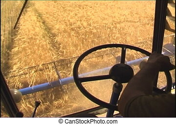 Farming. - The Combine takes away the wheat.