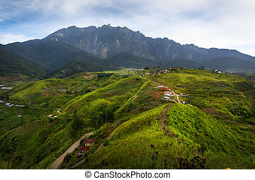 Farming village and Mount Kinabalu view from Sosodikon Hill...