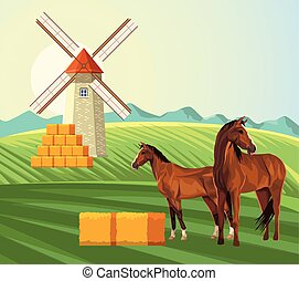 farming windmill bales of hay and horses in the field