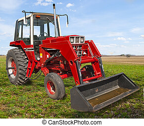A Old Red Tractor used in Farming