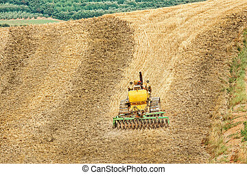 Farming with tractor and plow in field
