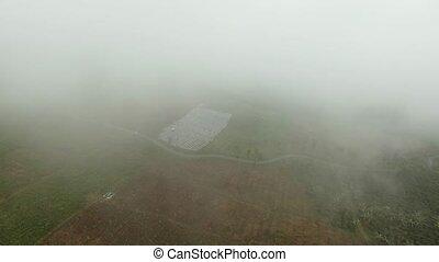 Farmland in the mountains in the fog. Jawa island, Indonesia...