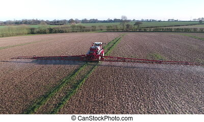 Farmland Sprayed With Glyphosate Herbicide - Farm machinery...