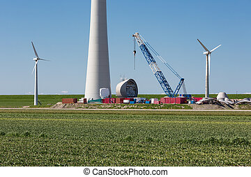 Farmland with construction work at the biggest windfarm of the Netherlands
