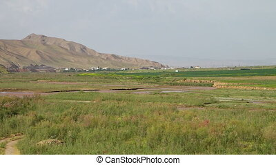 Farmland With Town and Mountain - Steady, exterior, wide...