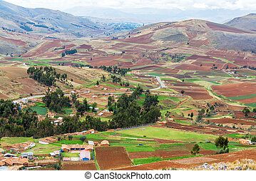 Farmlands in Peru - Farms covering a valley and hill in...