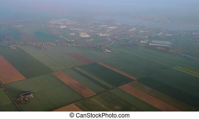 Farms from above - Flying over the Netherlands, view of...