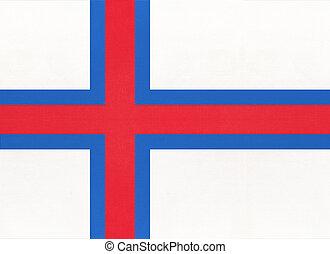 Faroe Islands national fabric flag with emblem, textile background.