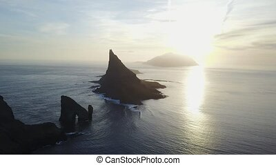 Faroe Islands, North Atlantic islands in sunset. Drangarnir...
