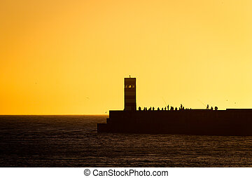 Farol do Pontao and People Silhouettes at Dusk