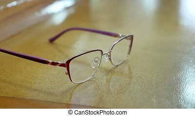 Farsightedness. Glasses for sight lie on the table -...