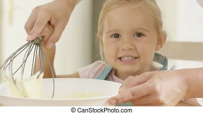Fascinated little girl learning to bake - Fascinated pretty...