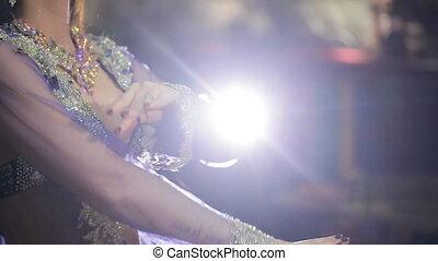 Fascinating dance of wonderful brunette in transparent...