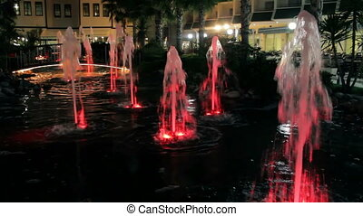 fascinating fountains illuminated with colored lights
