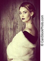 fascinating woman - Beautiful young woman wearing mink fur...