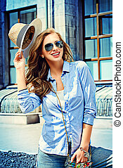 fascination - Beautiful young woman walking in the city. ...