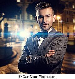 Fashion. Adult gentleman standing on the street - Fashion,...