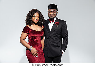 Fashion afro american couple standing isolated on a white...
