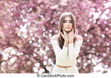 Fashion Art Beauty Portrait. Beautiful Girl in Fantasy Mystical and Magical Spring Garden. Model