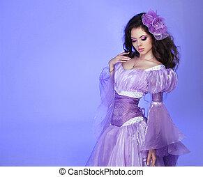 Fashion Art Beauty Portrait. Beautiful Girl Model Woman wearing purple luxuriant dress.