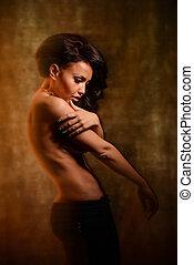 Fashion art photo of a beautiful girl in mixed light