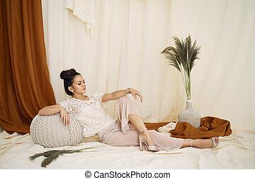 art photo of brunette woman in studio interior.