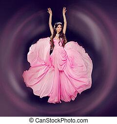 Fashion art photo of young beautiful woman in blowing dress. Studio photo