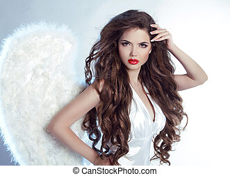 Fashion Beautiful Angel Girl model with wavy long hair