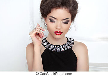 Fashion beautiful brunette young woman with makeup and luxury ne