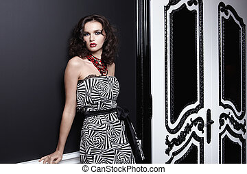 Beautiful girl in a dress on black background