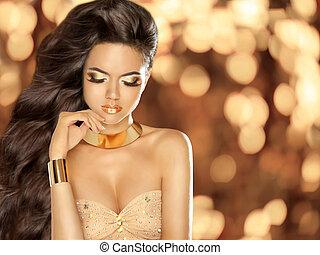 Fashion Beautiful girl with Long Wavy Hair wearing in golden...