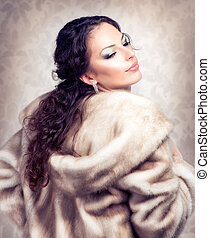 Fashion Beautiful Woman in Luxury Fur Mink Coat