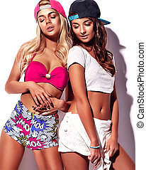 Fashion beautiful young brunette and blond models in rnb...