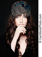 Fashion Beauty. Beautiful Woman with Curly Brown Hair